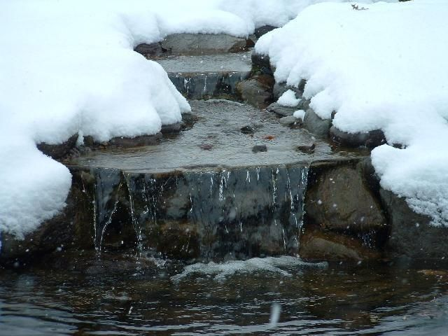 Waterfalls still beautiful in wintertime ponds water for Koi pond in winter