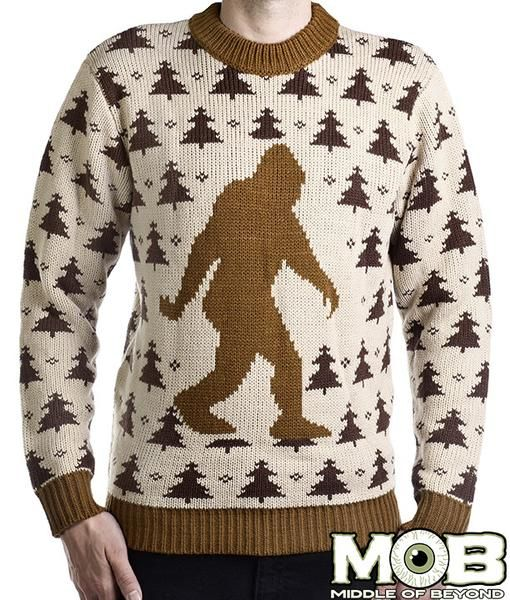 Product in Stock Ships in 1-2 Days Lets go Squatchin! This sweater made of 100% acrylic. Cream, brown, and tan in color. It is decorated with a big sasquatch on the front and a repeating tree design.