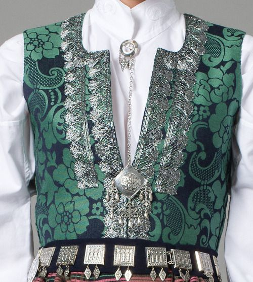 Silver and embroidery detail on a bunad (Norwegian folk costume) from Nordmøre. (via.)