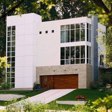International- Contemporary Style       The exterior of this trilevel home is clad in Trespa Meteon, a distinctive waterproof siding made in Germany. Arriscraft, a composite stone, frames the red cedar garage door that integrates with the entryway.        Several features tie the home to International-style architecture of the 1930s: unadorned, stark white surfaces, a facade that expresses the strength of its steel core, and a rectilinear design with a nonstructural skin of innovati