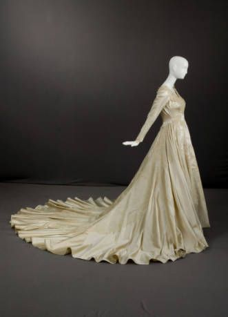 1954 Wedding gown of Silk satin and lace by Priscilla of Boston.  Worn by donor, née Grace Dickerman Vogel on the occasion of her first marriage to Michael Hartman Finnell in 1954. It was subsequently worn by her sister, Mrs. Walter Gray Mattern, Jr. in 1959, and by her daughter, Mrs. Frederick Clifford Blanchard, Jr. in 1981.