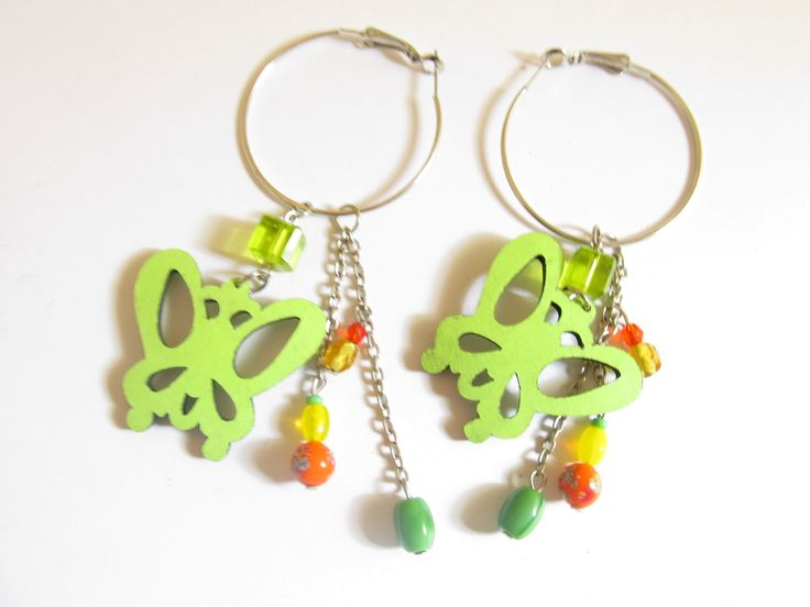 Handmade laser cut leather earrings (1 pair)  Made with light green leather butterfly, silver tone antiallergic earring hoops and glass beads.