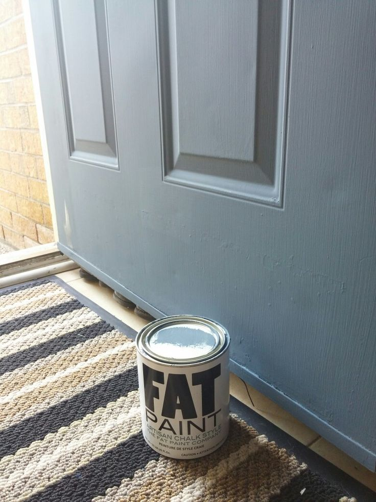 Front door DIY repaint with Fat Paint. Slate Blue pops against the yellow brick.
