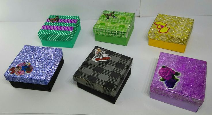 These miniature gift boxes is made with color papers.