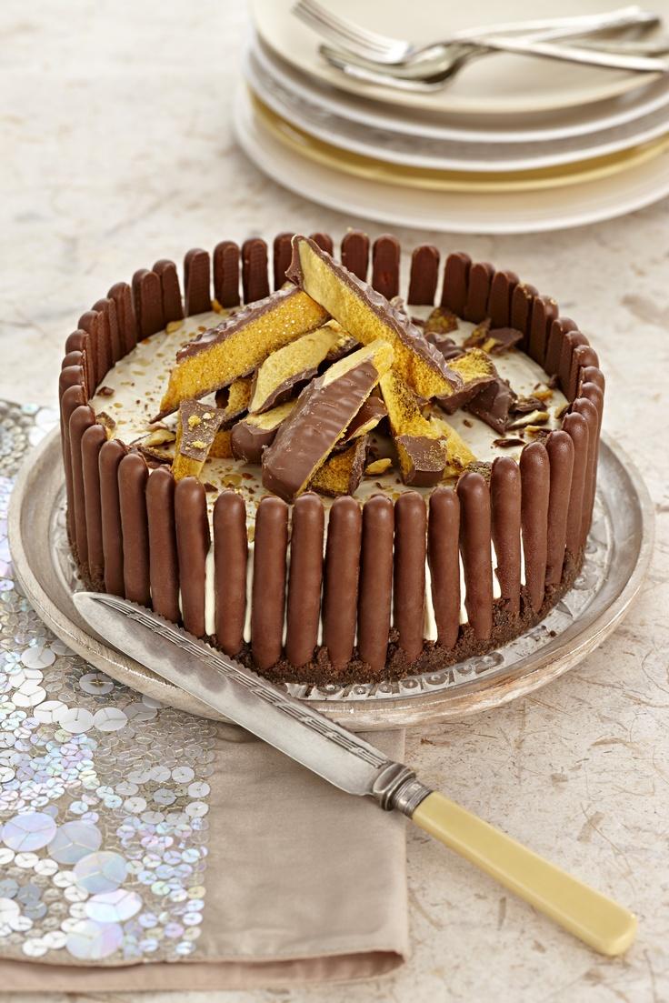 Crunchie Bar Cheesecake surrounded by Cadbury Honeycomb Fingers. #food #cheesecake #dessert