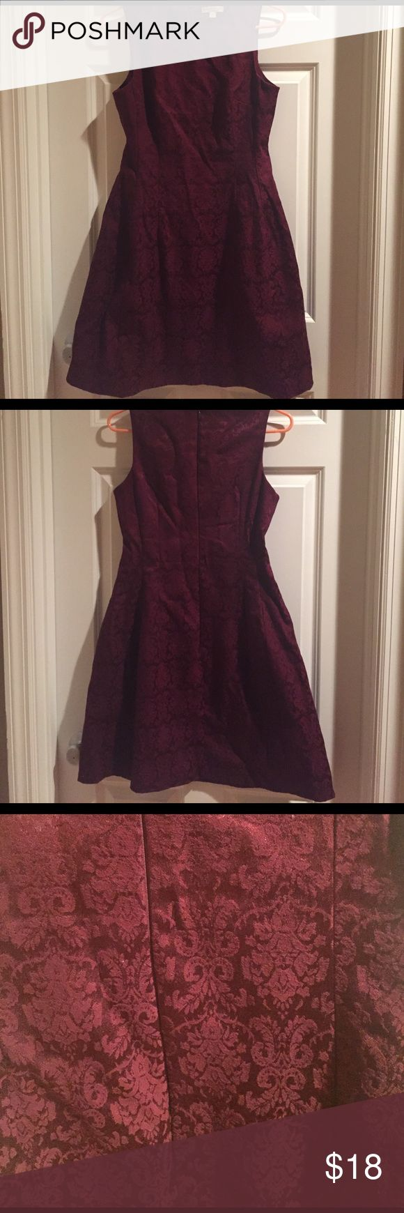 Burgundy Eves Mendes NY&C Sleeveless Dress Size 10. Burgundy jacquard Eva Mendes for New York & Company sleeveless dress. Shell - 52% cotton, 46% polyester, 2% spandex. Lining - 100% polyester. New York & Company Dresses