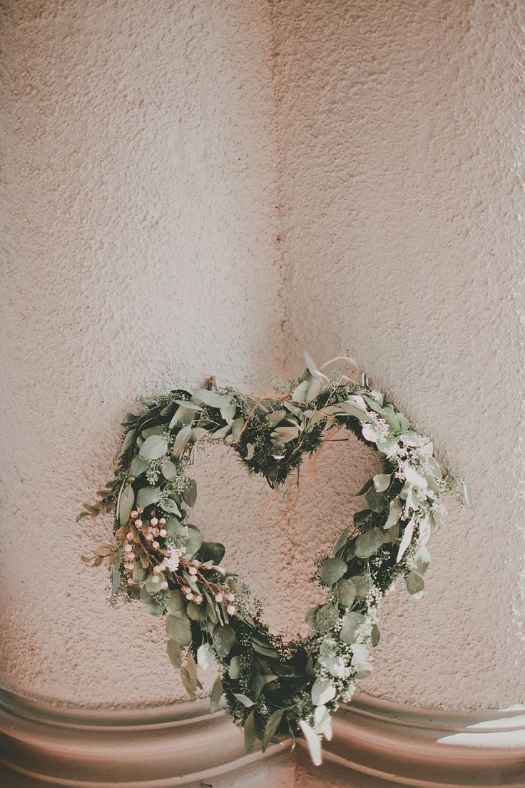 DIY Eucalyptus Heart Wreath made by the bride | via: Style Me Pretty