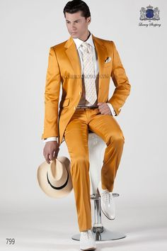 Gold-tone cotton satin suit with notch lapel with 2 buttons closure. Flap pockets and straight buttonholes. Twin vents at back, style 799 Ottavio Nuccio Gala, 2015 Fashion Collection.