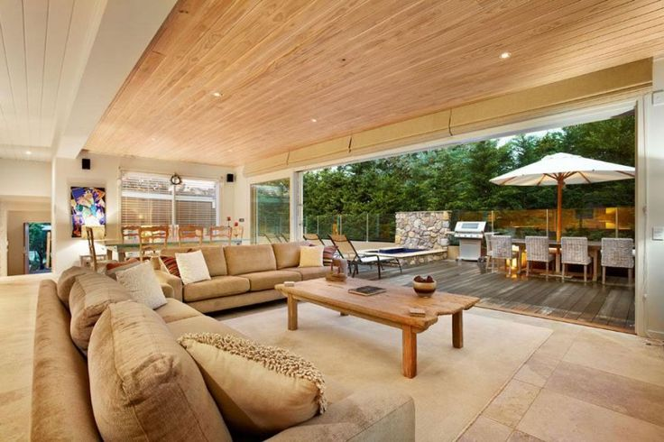 Level Home in Back Beach Open Floor to Terrace Decorated with Brown Sectional…