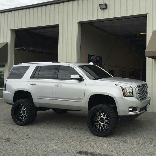 2016 GMC Yukon Denali with Fabtech lift KMC wheels 22x12 and Nitto 355/40R22 tires!