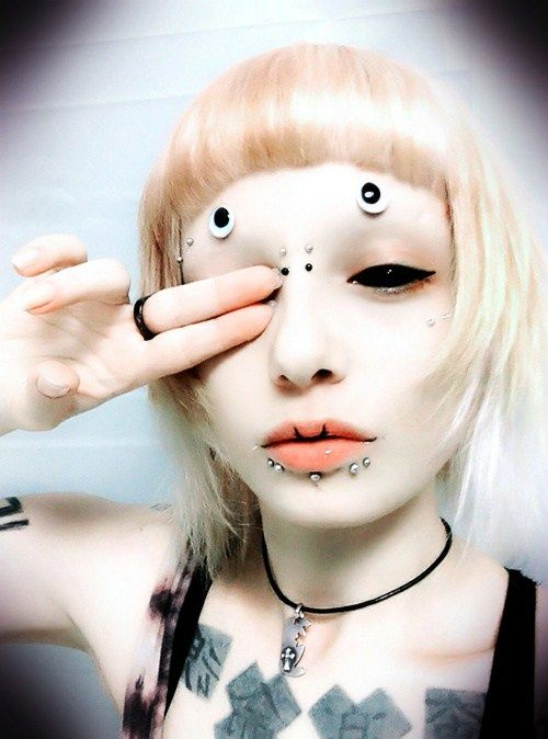 Sclera lenses and piercing - cool Cyber Gothic Style. Like it? Create your style at http://www.fantasmagoria.eu