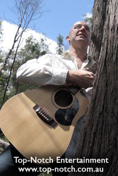 Pre dinner wedding entertainment, acoustic guitar soloist musician.  www.top-notch.com.au  www.facebook.com/WeddingDJTopNotch