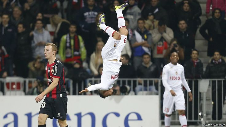 Monaco forward Emmanuel Riviere (C) celebrates with a flip after scoring a goal during the French L1 football match between Nice (OGC Nice) ...