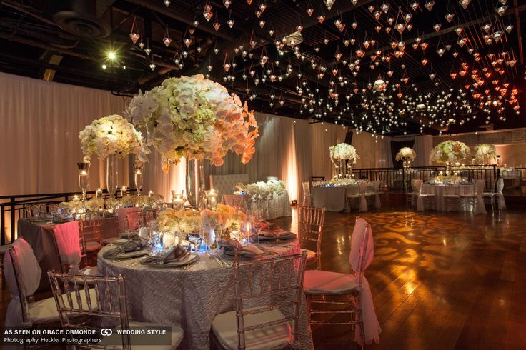 Crystal vases embellished with roses, orchids, hydrangea set below 1,000 hanging candle  #GOWS #platinumlist #eventdesign #wedding #weddings #weddinginspiration #weddingplanning #decor #luxuryweddings