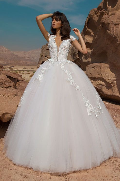 Stunning Pnina Tornai Wedding Gown Cinderella ball gown in off white blush tulle and Guipure lace that is fully beaded with Swarovski marquis shaped stones and