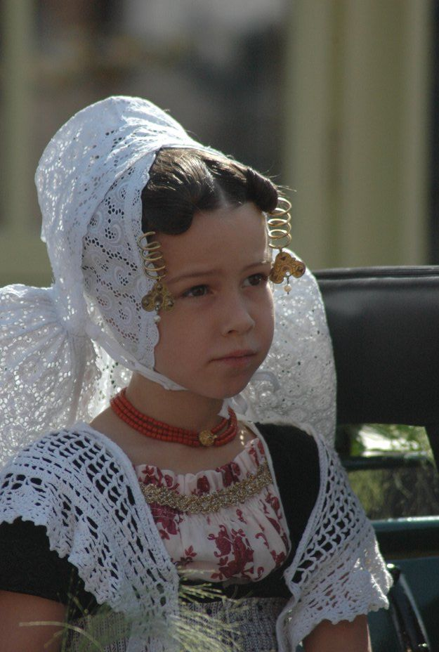 """Beautiful! I think this is the Zeeland or Walcheren costume - note the coral beads and gold coil """"kissers"""". Love the crocheted shawl"""