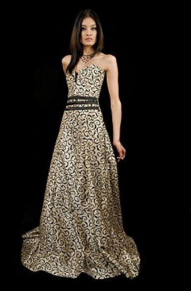 Award Winning Black & Gold Gown - This dress shows of your elegant shoulder line and arms with a little emphasis to the bust line and highlighting your doll-ish torso and simply swishing downward over your thighs. Bingo!!