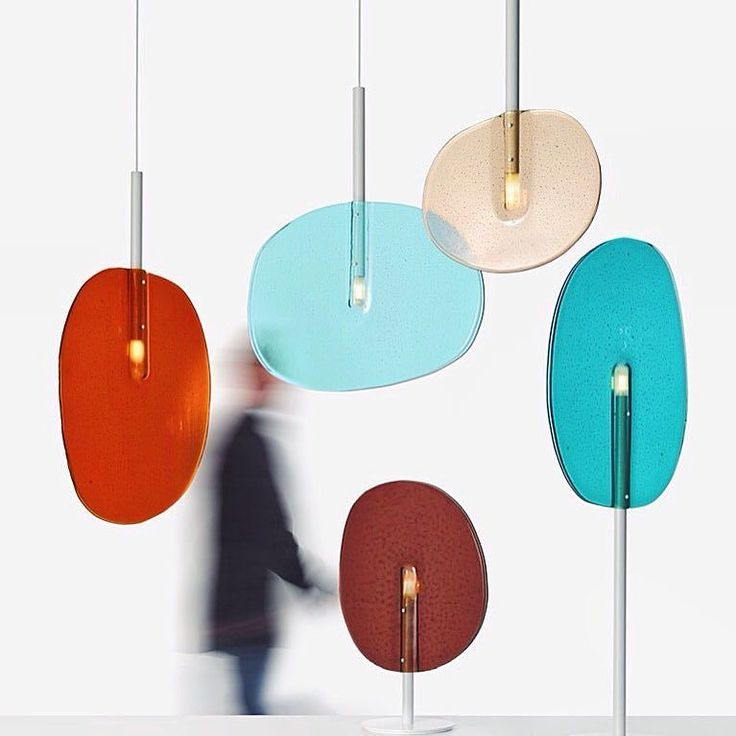 The Lollipop collection by @borisklimek for @lasvitdesign was inspired by a fascination with transparency & perception - moments of peering through a green glass bottle or a colored lens. Using the technique of slumped glass the Lollipop collection consists of table & stand-alone lamps as well as pendant lights - a colorful mix of organic transparent lighting pieces to inspire your space.  . . Join us Monday May 22nd from 6-9pm for our third-annual celebration of @NYCxDESIGN in showrooms…