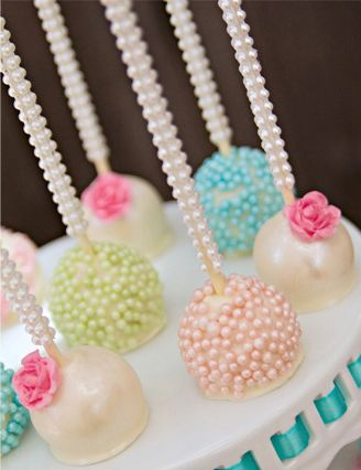 Pretty Cake Pops- for the party? Love these! Visit www.weddingacrylics.co.uk for your cake decorating and sugarcraft supplies!