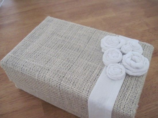 Decorate an old shoe box with fabric scraps to transform it into a beautiful organizational box