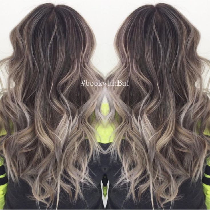 beautiful long dark brown hair with lots of cool tone ash blonde highlighted balayage.