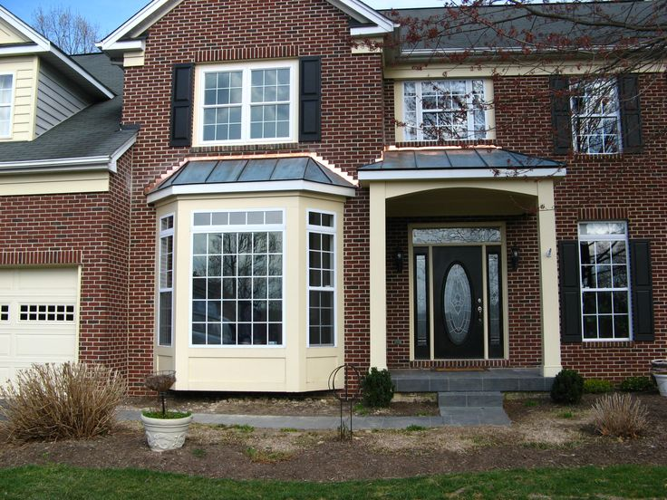 Entry Portico And Walk Out Bay Window With Copper Roofs