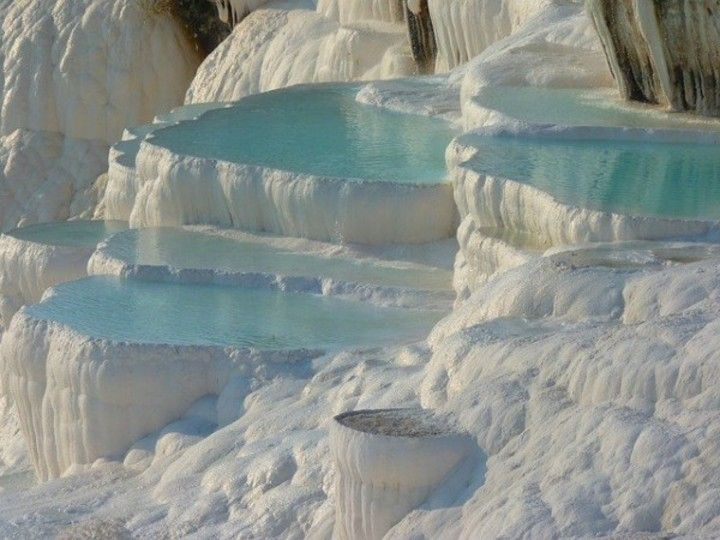 "Pamukkale meaning ""Cotton Castle"" is an unique natural phenomena, located in Denizli Province in southwestern Turkey.  This amazing place contains hot springs and travertines, terraces of carbonate minerals left by the flowing water. This magical place brings thousand of tourists every year, being famous not only for the breathtaking surroundings but also for the healing and relaxation powers of the waters."