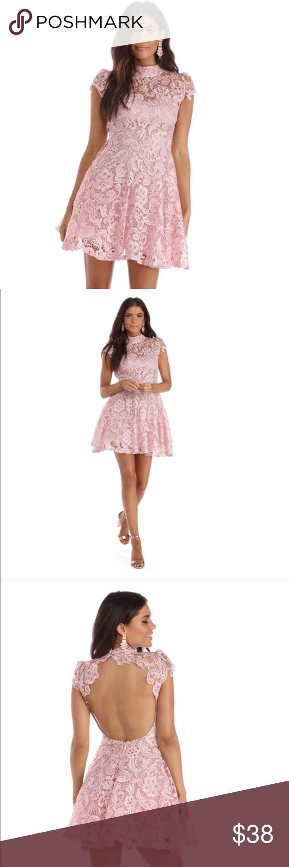 """Classy Pink Lace Dress  Because everyone loves a lace party! This cute homecoming style livens up the night with a mock neck that closes with two gold button, scalloped cap sleeves and a large open back. The dress has a playful skater skirt with a tulle underlay and is composed of a sheer crochet lace paired with a thin sweetheart lining.  Model is 5'9"""" with a 32"""" bust, 25"""" waist and 35"""" hips. She is wearing a size small. Windsor Dresses Prom"""