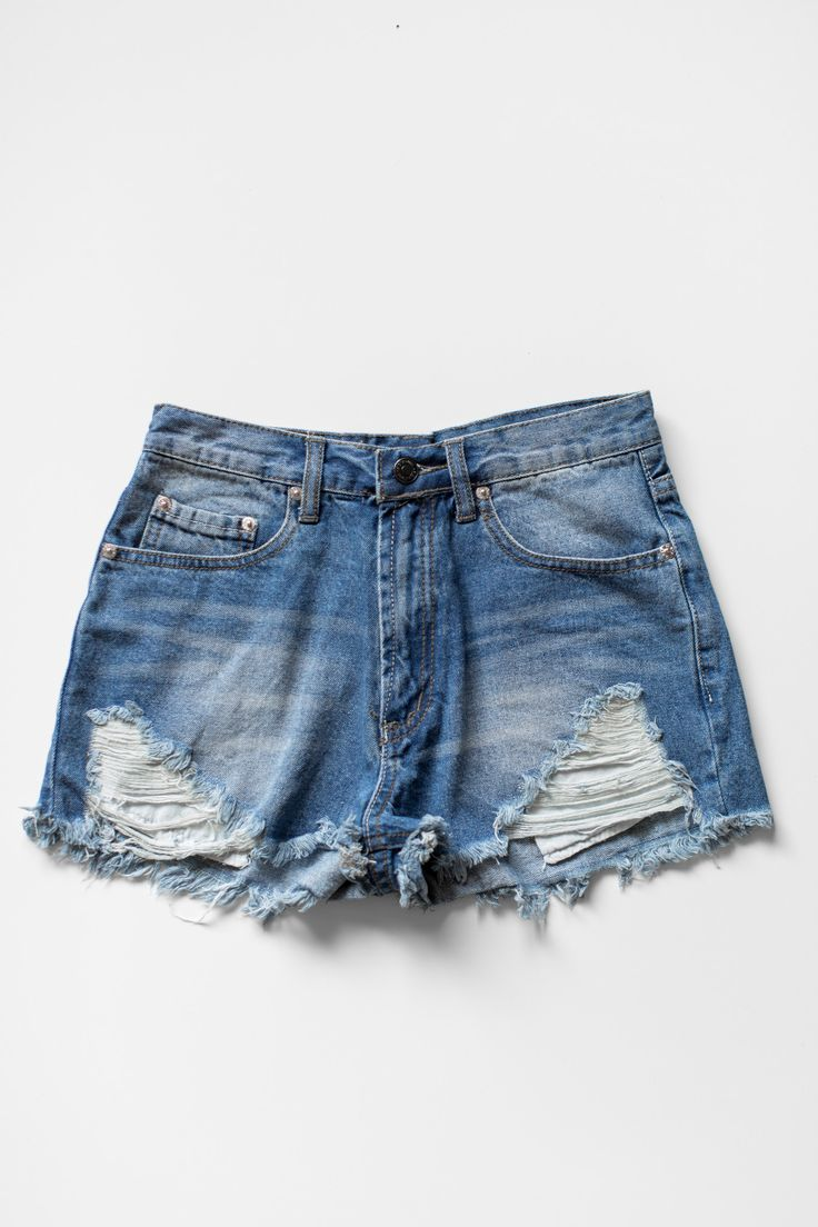 Vintage inspired high waist denim shorts with distressed and frayed detailing. Classic zipper and button closure with 2 front pockets and 2 back pockets. These shorts are fitted and made with non-stre