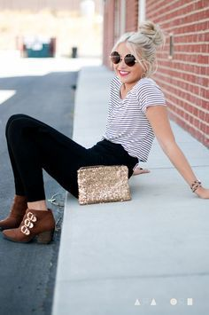 Striped shirts are a classic, and look great tucked into high-waisted jeans… ankle boots add a nice touch.