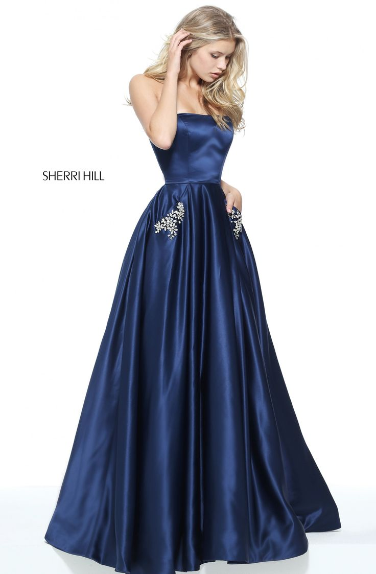 Beading accents the side pockets on the ball gown skirt of this Sherri Hill 50812 straight strapless prom dress with a semi-open back. The skirt cascades from the waistline into a full-length hemline.