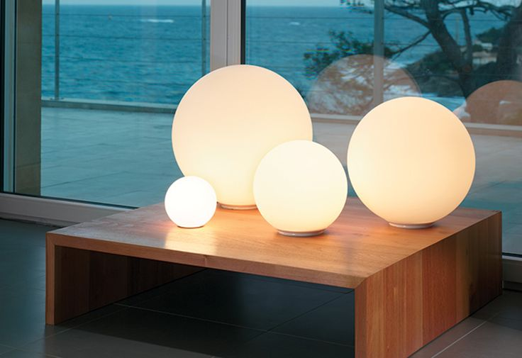 Dioscuri table lamp by Michele De Lucchi for Artemide.  Spherical table lamp for diffused incandescent lighting.  A minimalistic design featuring a classic, simple globe in acid-etched blown glass atop a hidden base of thermo-plastic resin.  Dioscuri 25, 35, and 42 are dimmable.  IP20 rated  Dioscuri 14  Bulb: max 1 x 60W halogen (G9) - (included)  Dimensions: 14dia x 13cmh  Dioscuri 25  Bulb: 1 x E27 halogen max 77W (not included)  Dimensions: 25dia x 23cmh  Dioscuri 35  Bulb: 1 x E27…