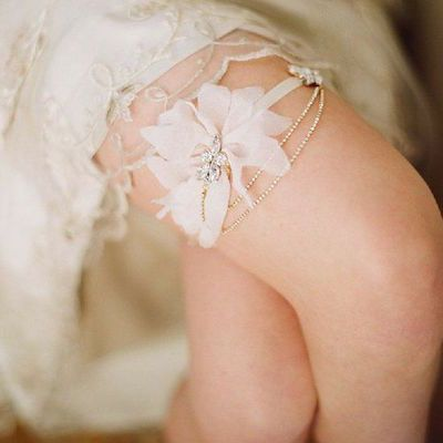 Flower and jewel chandelier bridal garter for wedding by Elizabeth Messina from…