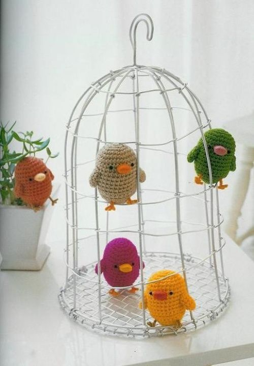 Crochet birds in a cage.