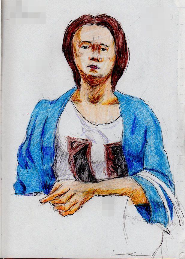 『紺色のカーディガンのお姉さん(電車でスケッチ)』This is a woman of sketch wearing a cardigan of dark blue.