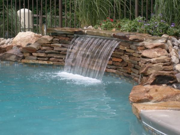 39 best images about stone waterfalls on pinterest waterfalls mosaic stones and pools for Building a swimming pool waterfall