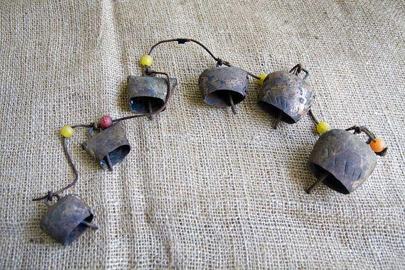 String of 6 Primitive Handmade Copper Farm Bells