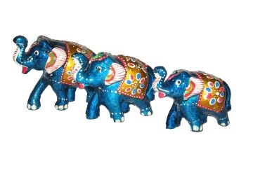 A unique show piece product having 3 different sized elephants made of wood and decorated with metallic color and beautiful design. This beautiful set of 3 elephants  will definitely give your show case a shade of rajasthan.
