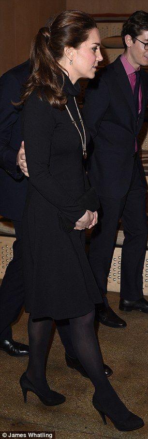Elegant: The Duchess of Cambridge wore a Seraphine roll-neck dress underneath the pink coat 9 dec 2014