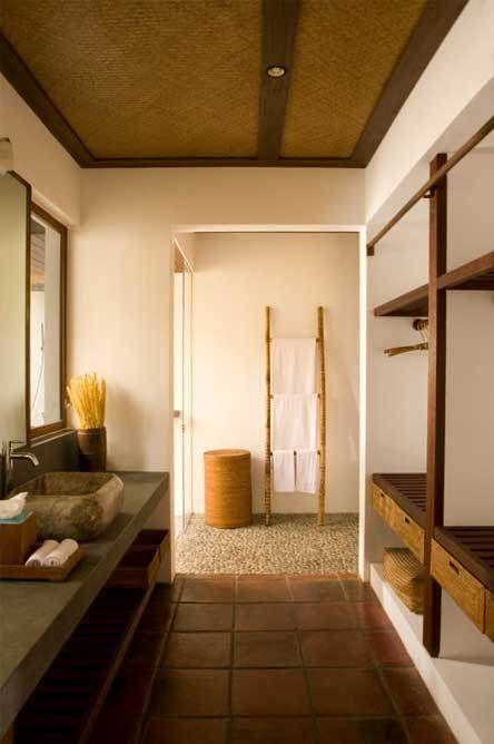 Terra cotta floors and pebble bathroom floor