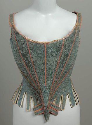 Stays. Fully-boned (whalebone). Blue silk damask in floral pattern; block printed cotton lining (brown floral pattern on ecru, similar to damask pattern). White kid tab binding and lining. Red silk tape over seams. Back lacing. Pocket at top front of Costume, fig. 1437; Payne, History of Costume, fig. 411a. French, about 1750