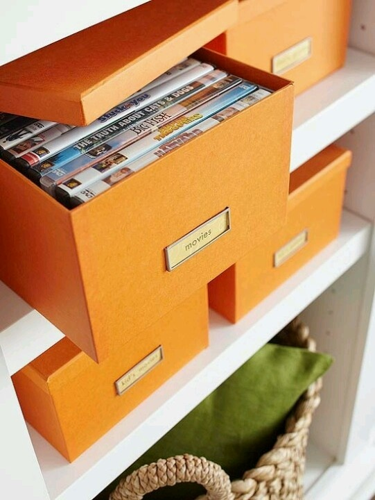 Love it!  Super-classy way to store DVDs, and it would be so easy to label the boxes with what's inside!  Then, just keep a handful of favorites out for cute display!