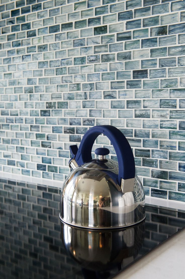 For our Beach House kitchen, Designer Denise Enright chose a mosaic tile backsplash that suggests the sea. By The Tile Shop.