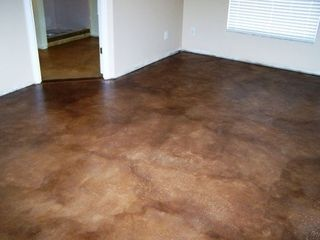 Stained Concrete Floor.  If you crumple Fritos on the set concrete before buffing and finishing, you get an awesome design pattern effect in the stain.