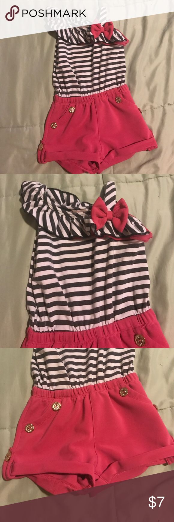 Hot pink, black and white stripe jumper Striped top with solid shorts.  A-symmetrical ruffle across the top with bow and strap make for super unique look. Tag says 3, but fits a 3T. Unik Matching Sets