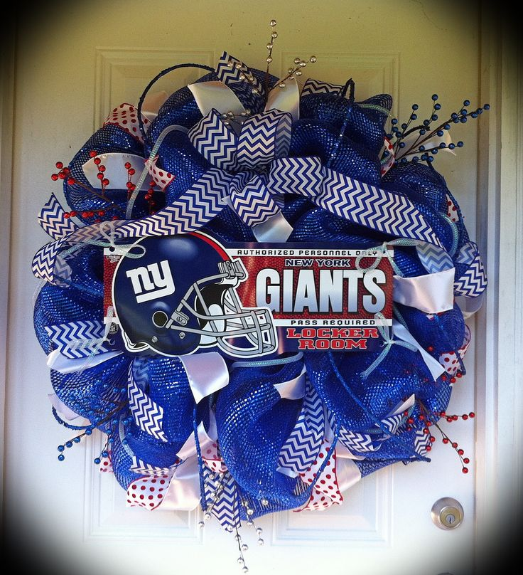 "New York Giants wreath! This mesh wreath includes 3 different types of ribbon, deco tubing, blue glitter rope, glitter sticks, and a New York Giants sign. Measures 28"" wide.  GO GIANTS!"