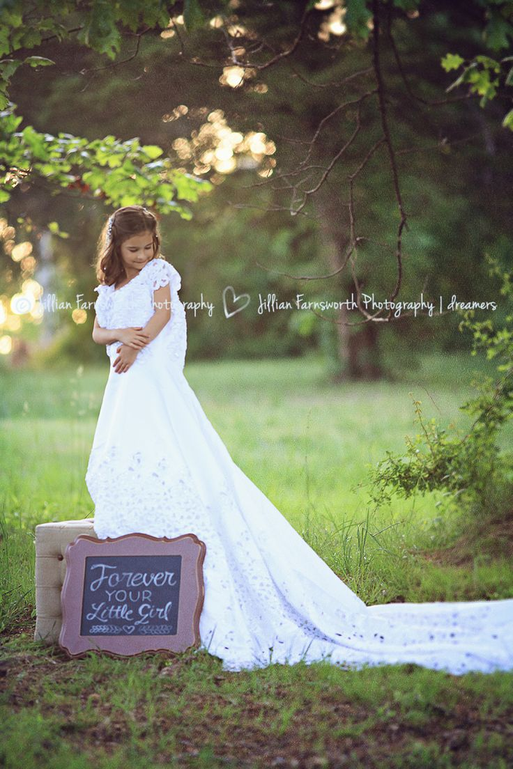 Daughter in moms wedding dress!  So cute!  Some pictures were used as a gift for dad on Fathers Day, could use this at their wedding someday too.  #jillianfarnsworthphotography #girl #weddingdress