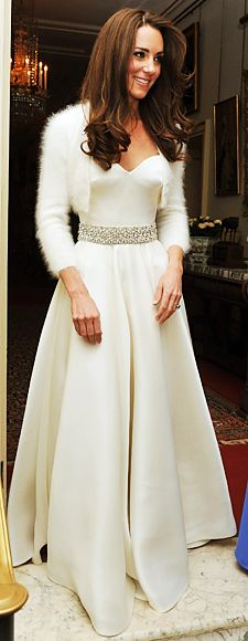 On her wedding night, Middleton changed into a satin gown and angora bolero by Sarah Burton for Alexander McQueen