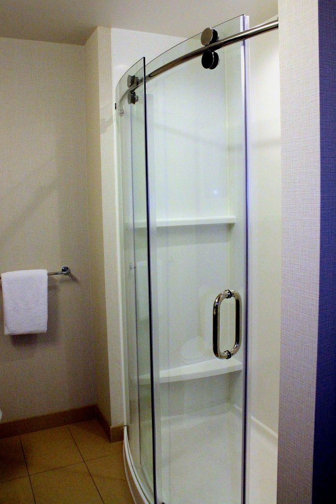 Curved Glass Shower Door With Visible Roller Sleek Beaut