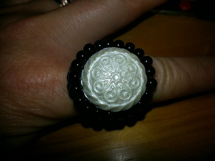 White button with Black bead embellishment on crochet ring